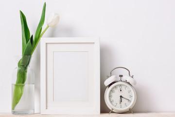 Frames, clock and flower