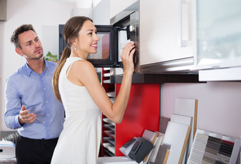 Positive assistant working with customer