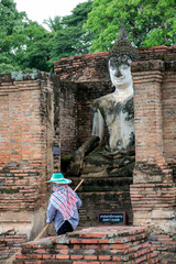 A worker is cleaning the grounds of world heritage site,Sukhothai.