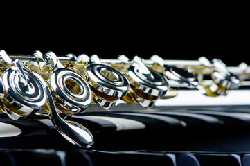 jazz music instrument flute close up isolated on black background
