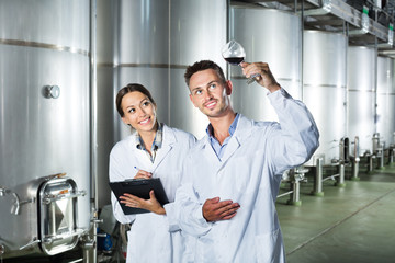 Man and woman employees on winery manufactory