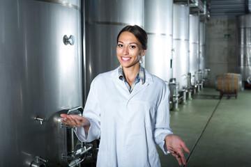 Portrait of female employee winery worker.