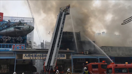 A still image taken from video shows smoke spewing from Tokyo's Tsukiji fish market in Tokyo