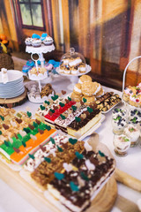 Candy bar on wedding ceremony with a lot of different candies and beverages