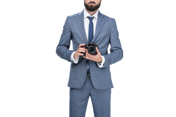 cropped view of male photographer holding professional camera, isolated on white