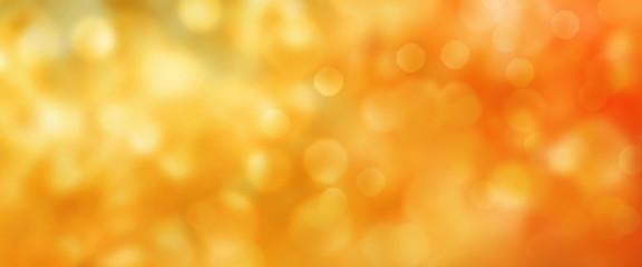 Abstract golden autumn bokeh background
