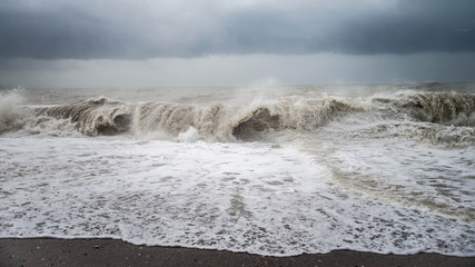 Autumn sea storm with huge splash from big waves during a storrm at the beach