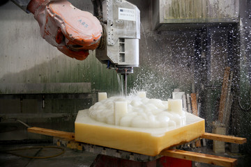 An ABB robotic arm is seen carving marble at the Henraux Company in Querceta