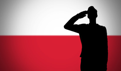 Silhouette of a soldier saluting against the poland flag