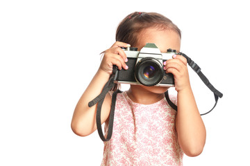 Little cute girl making photo on white background.