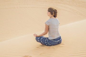Young woman meditating in the desert