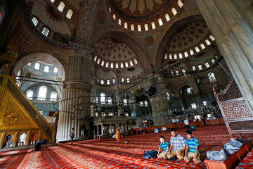 Visitors pray at the Ottoman-era Sultanahmet mosque, also known as the Blue Mosque, in Istanbul