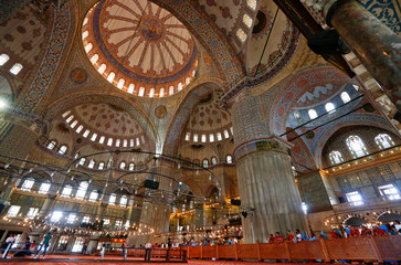 Tourists visit the Ottoman-era Sultanahmet mosque, also known as the Blue Mosque, in Istanbul