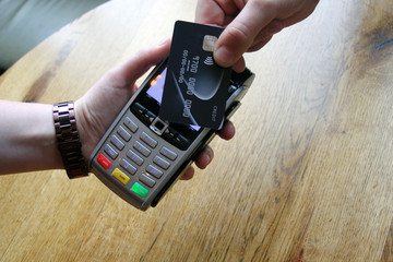 contactless payment card pdq background copy space with hand holding credit card to pay stock photo, stock photograph, image, picture,