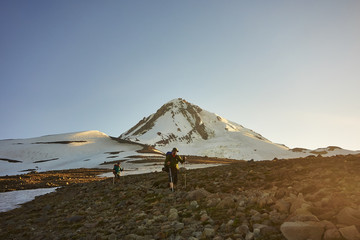 A backpacker hiking along the Timberline Trail of Mt Hood.
