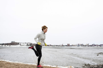 Woman running on trail around Back Cove