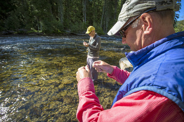 Two men fish the Yaak River in remote NW Montana.
