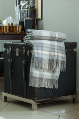 checkered plaid on  vintage trunk