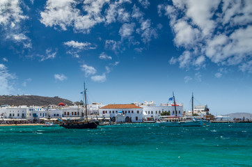 MYKONOS, GREECE - JULY 4, 2017: Beautiful view of Mykonos town in Cyclades Islands. There are white houses and boats in the old harbor.