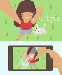 doing selfie for social networks and friends. The photo on the front camera. Girl walking her dog