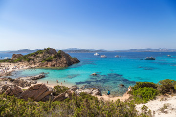 Archipelago of La Maddalena, Italy. Picturesque bay with a beach and clear water