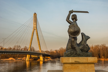 The Warsaw Mermaid near bridge Swietokrzyski over the Vistula river in Warsaw, Poland