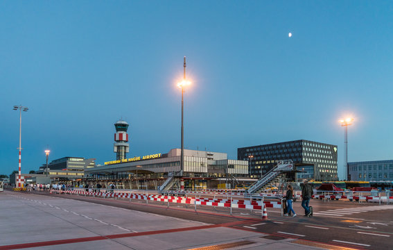 Rotterdam, The Netherlands, July 2 2017: travelors walking to the main building of the Rotterdam The Hague airport