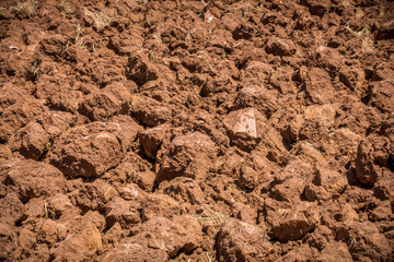Close up of plowed red soil. Arable land in Algarve Portugal.