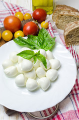 Fresh mozzarella with yellow tomatoes and basil.