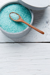 Turquoise bath salt in cup