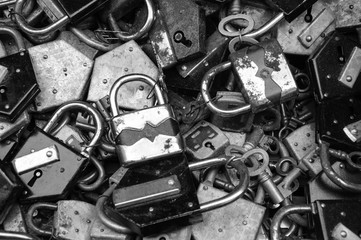 Old rusty locks and keys at flea market. Security, censorship or suppression concept. Black and white.