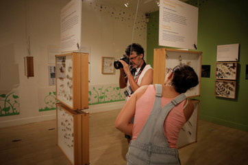 A tourist takes a picture at the National Museum in San Jose, Costa Rica