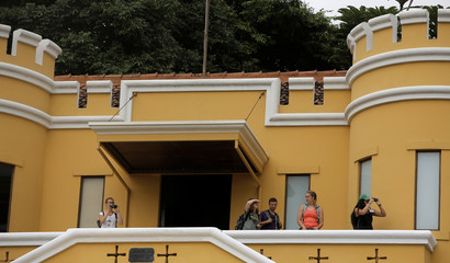 Tourists take pictures from National Museum in San Jose, Costa Rica