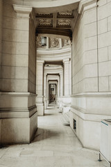 External corridor of a neoclassical building with columns and stairs