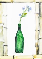 fresh blue flowers in bottle in frame of bamboo