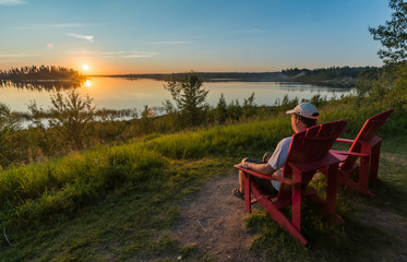 Man Relaxing on Chair Looking at Sunset