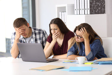Worried business team watching on line content
