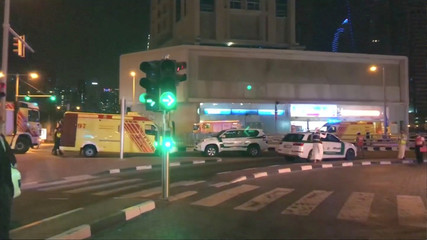 A still image taken from video shows emergency vehicles near the scene of the fire that broke out at Dubai's Torch Tower