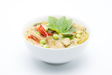 Thai food called Gang Keow Wan; green curry in the white bowl