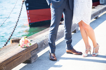Female and male leg, feet. Bride and groom shoes. Wedding details