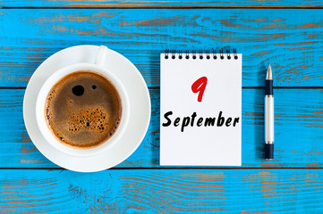 September 9th. Day 9 of month, coffee or tea cup with loose-leaf calendar on designer workplace background. Autumn time. Empty space for text