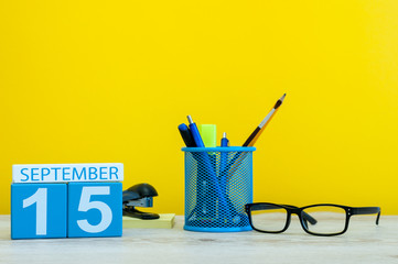 15th September. Image of september 15, calendar on yellow background with office supplies. Fall, autumn time