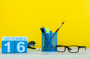 16th September. Image of september 16, calendar on yellow background with office supplies. Fall, autumn time