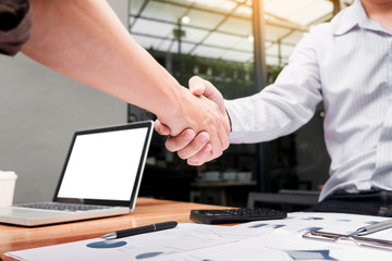 Two confident business man shaking hands during a meeting at outdoor, success, dealing, greeting and partner concept.
