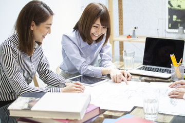 Women are making meetings with laptop and electronic tablet