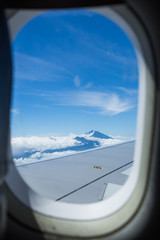 Airplane window and Bird's-eye view. Seen volcano mountain Rinjani of Indonesia.