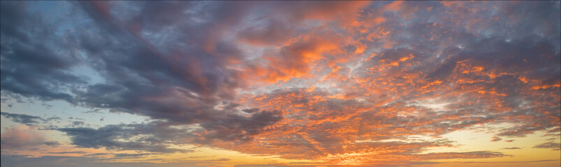 Fiery sunset, colorful clouds in the sky Wall mural