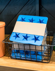 Blue star silicone ice cube tray in basket for sale.