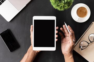 hand showing digital tablet blank screen on work desk