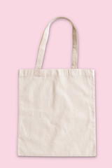 Tote bag fabric cloth shopping sack mockup isolated on pink background (clipping path)